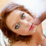 Hot redhead Sasha Summers takes a long thick rod with pleasure